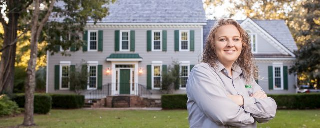 terminix employee in front of the house