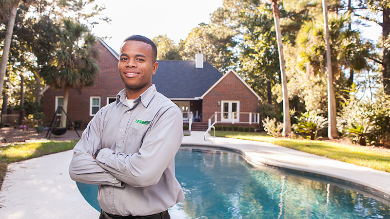 terminix employee standing in front of the house