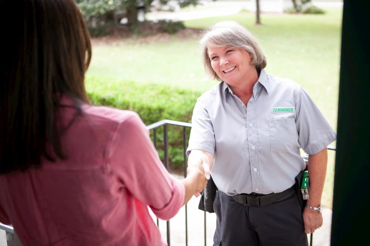 terminix employee shaking a customer hand